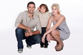 Studio shot of parents and their young son