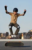 Boy Jumping From Skateboard