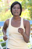 African-american Female Exercising, Running Outside