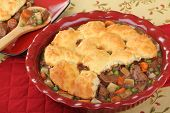 stock photo of stew pot  - Beef and vegetable pot pie with biscuits - JPG