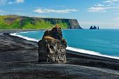 pic of promontory  - Beautiful rock formation on a black volcanic beach at Cape Dyrholaey - JPG