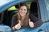 Happy Female Driver Showing Thumbs Up