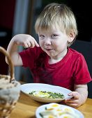 Young Boy Eating Spinach
