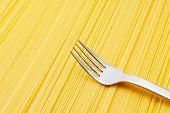 Silver spoon on spaghetti