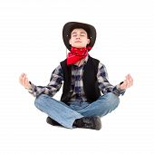 Young Handsome Man In Cowboy's Hat Meditates