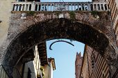 Arch Between Piazza Erbe And Signori In Verona With Hanging Whale Bone, Veneto, Italy