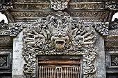 Stone sculpture on entrance door of Pura Padmasana Puja Mandala. Nusa Dua, Bali . Indonesia