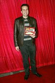 UNIVERSAL CITY - DEC. 4: Paul Tirado arrives at publicist Mike Arnoldi's birthday celebration & Brit