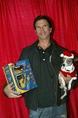 UNIVERSAL CITY - DEC. 4:Lorenzo Lamas & his dog Blueberry arrive at publicist Mike Arnoldi's birthda