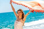 Cute Girl Playing With Scarf On Beach.