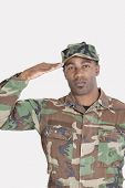image of united states marine corps  - Portrait of an African American US Marine Corps soldier saluting over gray background - JPG