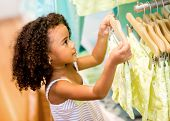 Young female shopper at a retail store looking for clothes