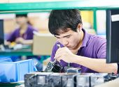 chinese male worker assembling production at line conveyor in china factory