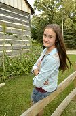 stock photo of split rail fence  - Portrait of female teen leaning on split - JPG
