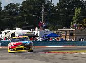 WATKINS GLEN, NY - AUG 11, 2013:  Kyle Busch (18) wins the Cheez-It 355 at The Glen race at the Watkins Glen International in Watkins Glen, NY on Aug 11, 2013.