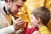 stock photo of communion-cup  - Orthodox Euharist ceremony - JPG