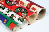 Four rolls of Christmas wrap.