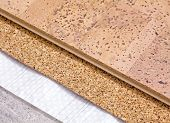 stock photo of floor covering  - Laying technology of cork floor on concrete base with layers of thermal insulation and soundproofing - JPG