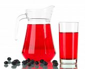 Pitcher and glass of compote isolated on white