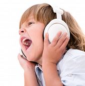 Little boy listening to music with headphones - isolated over white background