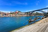 Oporto Or Porto Skyline, Douro River, Boats And Iron Bridge. Portugal, Europe.
