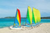 Sail Boats with colorful sails on tropical beach, Catamarans