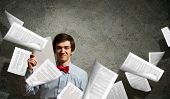 Tired young man with Scattered Documents