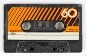 stock photo of magnetic tape  - an old retro vintage audio cassette against white - JPG