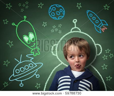Imagination and dreams of a child, dressed as a space man in front of a blackboard with chalk drawin poster