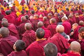 KHATMANDU, NEPAL - DEC 15: Unidentified tibetan Buddhist monks near stupa Boudhanath during festive