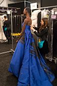 NEW YORK-FEB 10: Model Ajak Deng gets ready backstage at the Dennis Basso fashion show during Merced