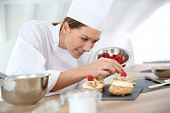 stock photo of pastry chef  - Chef preparing pastries for restaurant - JPG