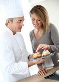 Pastry cook having woman tasting pastries