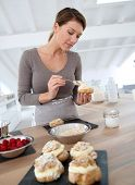picture of cream puff  - Woman in kitchen preparing cream puffs - JPG