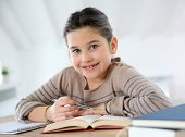 Portrait of 8-year-old girl doing homework