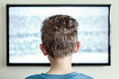 stock photo of hypnotic  - Boy watching Television with noise - JPG