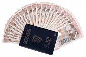 Croatian passport with Croatian money, isolated on white