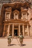 PETRA, JORDAN - MAY 11, 2013: nabatean soldiers in front Al Khazneh or The Treasury