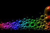 Bubbles In Rainbow Colors Bakground