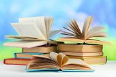 picture of short-story  - Stacks of books on table on natural background - JPG