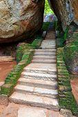 old stairs among stones in Sigiriya Castle, Sri Lanka