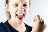 Angry Girl Screaming And Show Your Fist