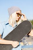 Beautiful Blonde Girl In Hat And Sunglasses With Skateboard