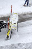 foto of snowy-road  - a snowplow in action on snowy road - JPG
