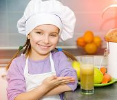 little girl show a fresh apple juice