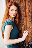 Outdoor Portrait Of Beautiful Redhead Young Woman
