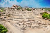 stock photo of vijayanagara  - Ancient ruins of Vijayanagara Empire at blue sky in Hampi Karnataka India - JPG