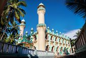 stock photo of mosk  - Mosque and palm trees around at blue sky in Varkala Kerala India - JPG