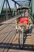 Tricycle On Old Bridge