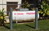Large Propane Tank In Landscaped Garden